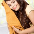 Young woman holding clean clothes — Stockfoto #59437831