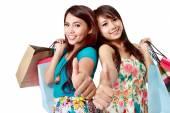 Shopping woman friend showing thumb up — Stok fotoğraf