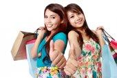 Shopping woman friend showing thumb up — Stock Photo