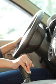 Driving and shifting car transmission with both hands — Stock Photo