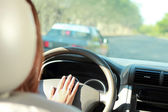 Driver use horn to warn car in front of her — Stock Photo