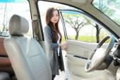 Woman open the car door — Stock Photo