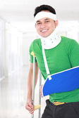 Injured young man keep smile — Stock Photo