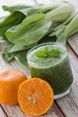 Bok choy chinesse cabbage and orange mix juice — Stock Photo