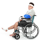 Injured young man in wheelchair — Stock Photo