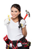 Woman holding tool showing thumb up — Stock Photo