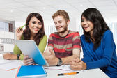 Group of diversity students studying using tablet pc — Stock Photo