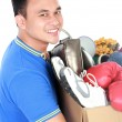 Happy young man carrying box full of stuff — Stock Photo #66373475