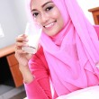 Young muslim woman drinking a glass of milk — Stock Photo #66382451