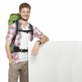 Man traveler with blank space board poster — Stock Photo