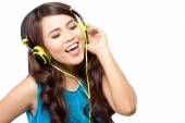 Young  woman sing while listening to music with headphone, isola — Stock Photo