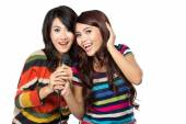 Two asian girls in striped t-shirt singing together — ストック写真