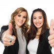 Young business woman making thumbs up gesture wearing blouse and — Stock Photo #70105671