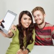 Two students taking a self portrait with a phone — Stock Photo #70542139