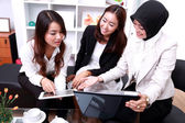 Three businesswomen interacting at meeting — Stock Photo