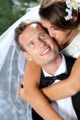 Bride kissing her groom — Stock Photo