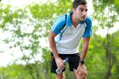 Sporty male runner taking a break after tired running — Foto Stock