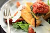 Italian cuisine polenta served with bolognese sauce — Stock Photo