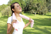 Sporty woman feel relax under the sunshine at park with fresh ai — Stock Photo