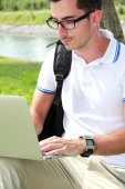 Colllege student working on assignments using laptop — Stock Photo
