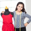 Young asian designer woman posing smiling, hold a scissors,  loo — Stock Photo #76795827