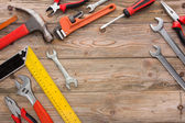 Mechanical kit in wooden background. construction tool — Stock Photo