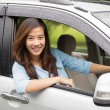 Happy young asian woman riding a car — Stock Photo #76840441