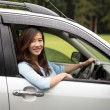 Happy young asian woman riding a car — Stock Photo #76840455