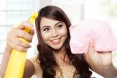 Beautiful young asian woman doing chores, holding sprayer and pi — Stock Photo