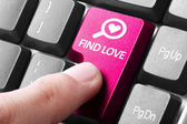 Hand press find love button on keyboard — Stock Photo