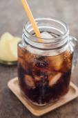 Iced cola with potato chips — Stock Photo