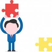 Unternehmer holding puzzleteil — Stockvektor