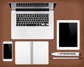 Laptop tablet, notepad and smartphone on the desk — Stock Photo