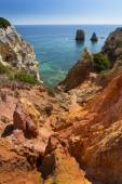 Coast with cliffs in Lagos at Algarve in Portugal — Stock Photo
