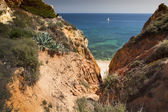Coast with cliffs in Lagos at Algarve in Portugal — ストック写真