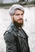 Bearded hipster with nose ring in leather jacket — Stock Photo