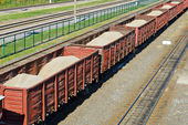 Rail freight wagons with sand — Stock Photo