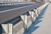 Safety barrier on freeway bridge — Stock Photo