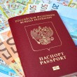 Russian passport and Euro banknotes on the map background — Stock Photo #72314967