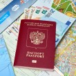 Russian passport and Euro banknotes on the map background — Stock Photo #72314983