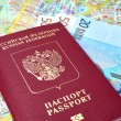 Russian passport and Euro banknotes on the map background — Stock Photo #72314985