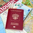 Russian passport and Euro banknotes on the map background — Stock Photo #72314991