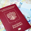 Russian passport and Euro banknotes on the map background — Stock Photo #72314995