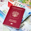 Russian passport and Euro banknotes on the map background — Stock Photo #72315001