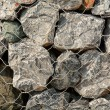 A volcanic stone and steel net fence texture — Stock Photo #71462939