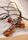 Crucifix on holy book — Stock Photo