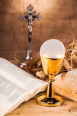 Holy communion next to bible — Stock Photo