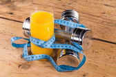 Fitness equipment and healthy orange juice — Stock Photo