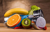 Fitness equipment and healthy food — Stock Photo