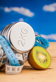 Fitness equipment , weights and kiwi — Stock Photo